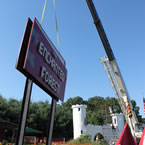 Putting new sign into place for the Enchanted Forest