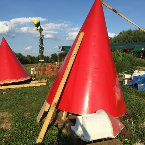 Sanding and painting the red spires in July was a very hot job.